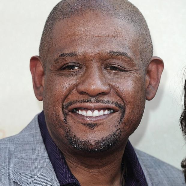 Forest Whitaker is taking on a Louis Armstrong biopic