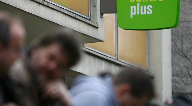 Firms are waiting to see what happens to the economy before taking on new staff, according to a new report
