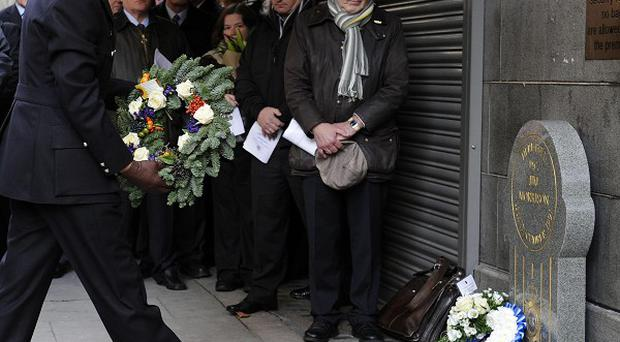 Met Police commissioner Bernhard Hogan-Howe lays a wreath during the memorial service for murdered DC Jim Morrison