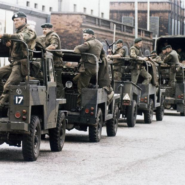 British troops moves through the streets of Londonderry in August 1972, a month after 15-year-old Daniel Hegarty was shot and killed (AP)