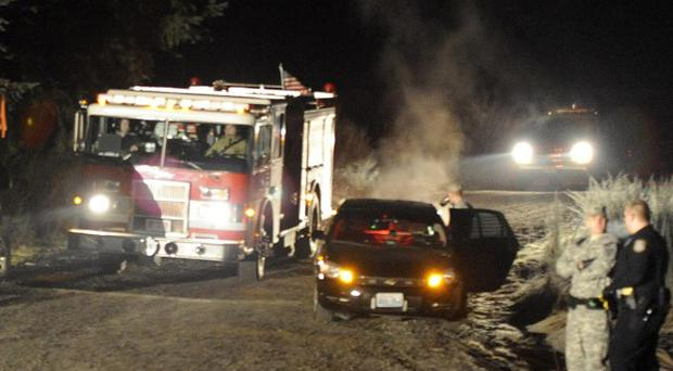 A fire engine leaves the scene in Thurston County where two Army OH-58 helicopters crashed (The News Tribune)