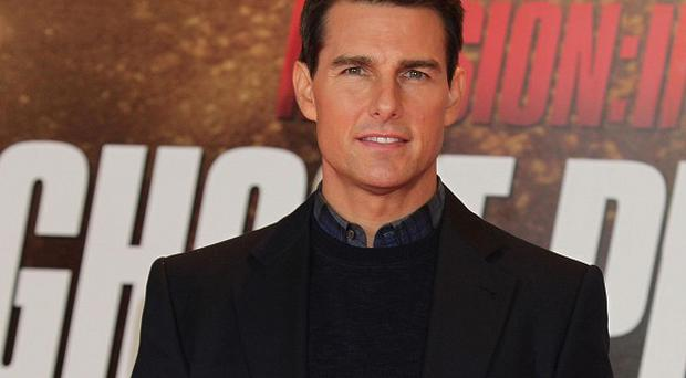 Tom Cruise arrives for the UK premiere of Mission:Impossible Ghost Protocol in London