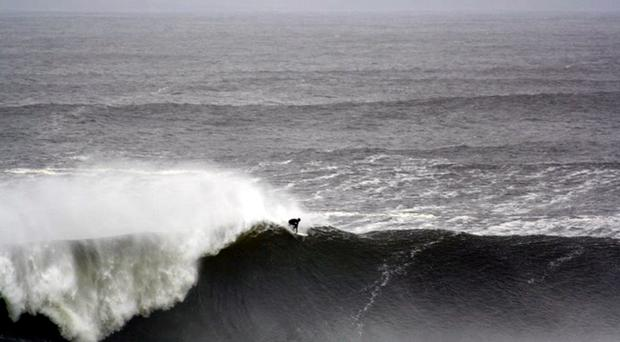 A brave surfer rides a 67-foot wave at Bundoran in Donegal yesterday, it was the biggest wave ever to hit Irish shores, recorded by a buoy 60 miles out to sea