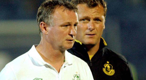 Good friends Jim Magilton (right) and Michael O'Neill are currently rivals for the Northern Ireland job