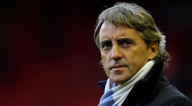 Roberto Mancini witnessed Manchester City's first league defeat on Monday night but it's unlikely to stall his team's march to the title