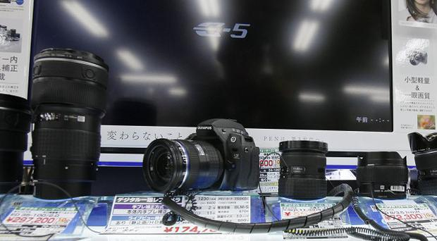 Olympus submitted revised earnings reports to Japanese regulators (AP)