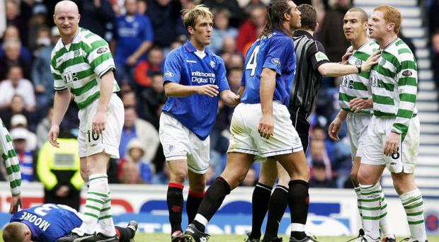 Tempers flare between Lorenzo Amoruso of Rangers and Neil Lennon of Celtic during the Bank of Scotland Scottish Premier League match between Glasgow Rangers and Glasgow Celtic held on April 27, 2003 at the Ibrox Stadium, in Glasgow, Scotland. Celtic won the match 2-1.
