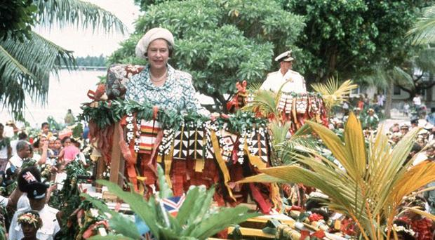 The Queen and the Duke of Edinburgh were carried shoulder high in canoes during their last visit to Tuvalu, in 1982