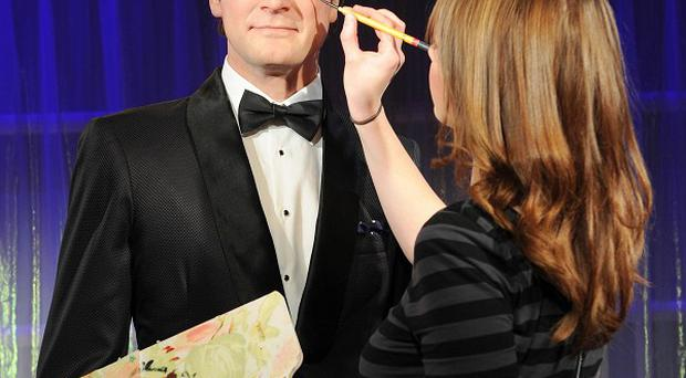 The finishing touches are applied to Colin Firth's wax figure