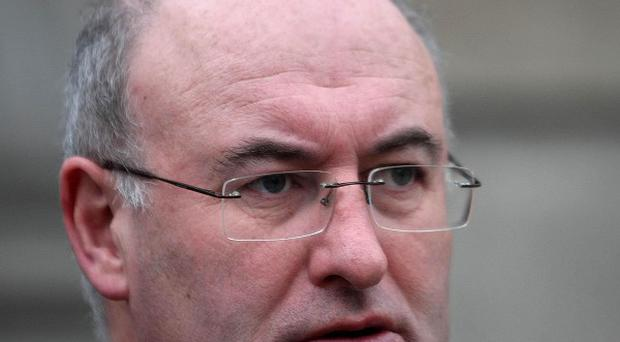 Environment Minister Phil Hogan has been urged to make his position clear after a court ruling on the plastic bag levy