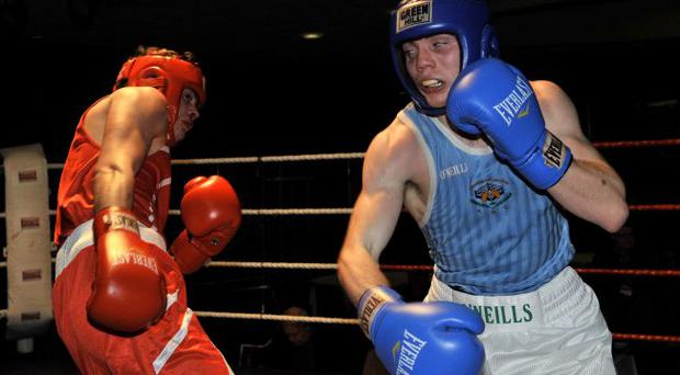 Eamonn Magee of Immaculata on his way to victory last night over Tyrone McKenna of Oliver Plunkett in the semi-finals of the Ulster Elite championships
