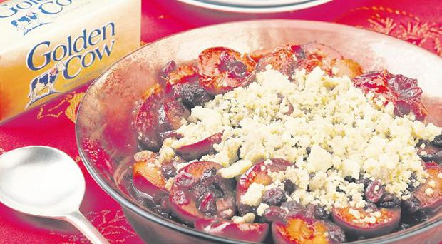 Buttery Chrsitmas crumble with plums, cranberry and orange