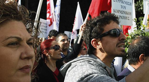 Government workers in Cyprus protest over a wage freeze and other spending cuts (AP)