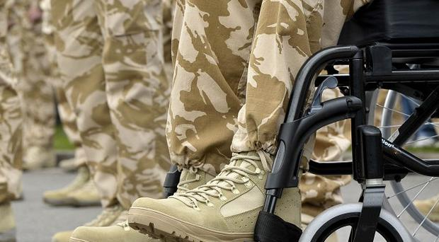 A group of MPs raised concerns over the future care of troops returning from service with severe injuries