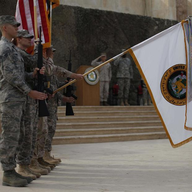 The US Forces-Iraq flag is lowered to mark the official end of the US military mission in Iraq (AP)