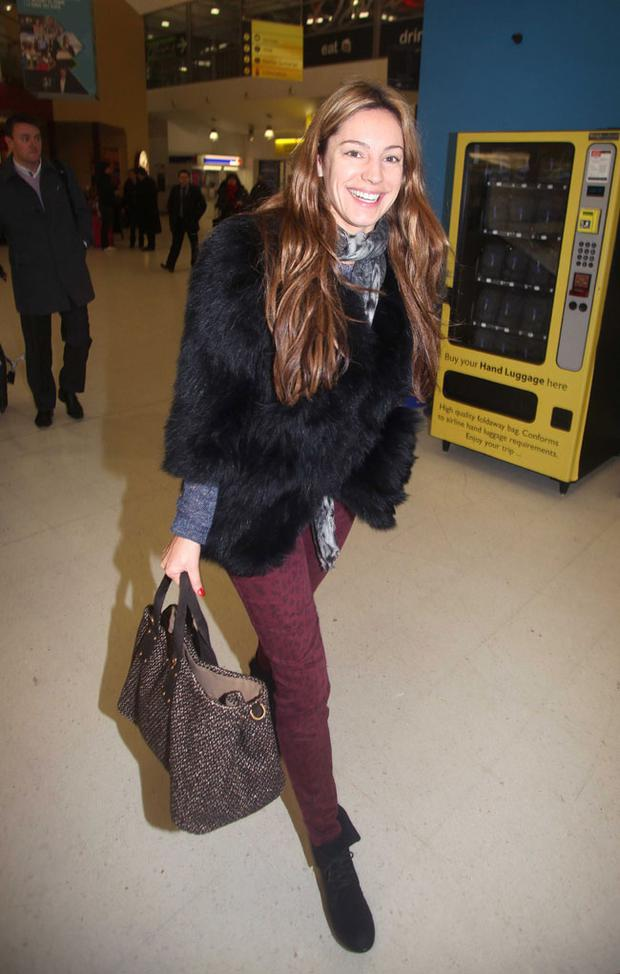 Kelly Brook arrives at Belfast City Airport
