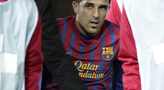 Bad break: Barcelona striker David Villa collapses in agony after breaking his leg