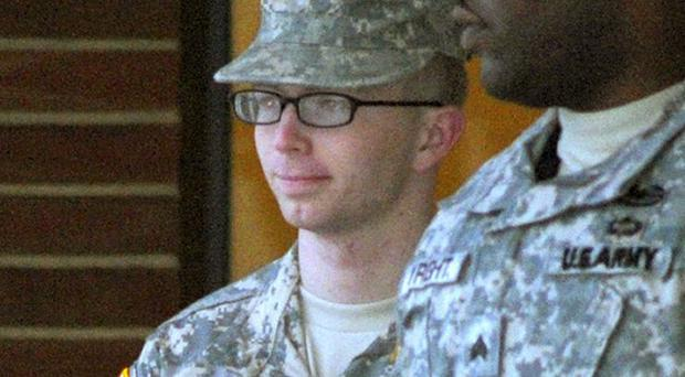 Private Bradley Manning, left, is escorted out of a courthouse at Fort Meade (AP)