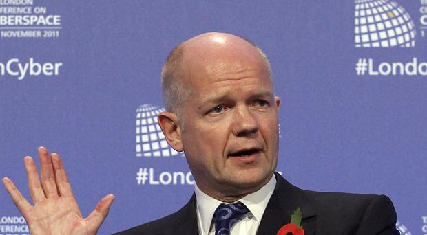 William Hague welcomed the decision to unfreeze the assets of two Libyan banks
