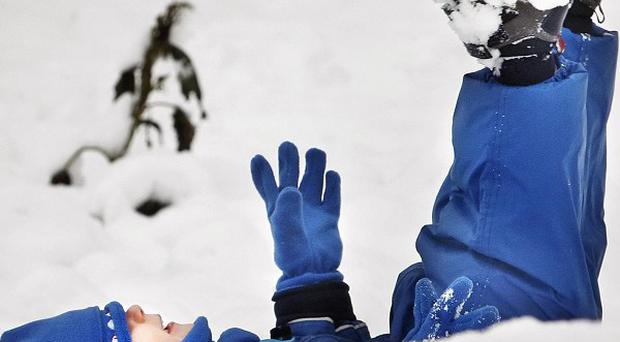 A two-year-old boy plays in the snow in Whitburn in West Lothian