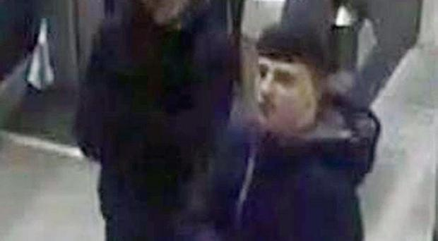 CCTV footage of two men police want to identify after a train inspector was stabbed in the back