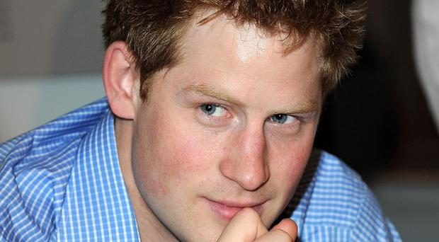 Prince Harry drove to help a friend who was mugged while speaking to the royal on his mobile phone