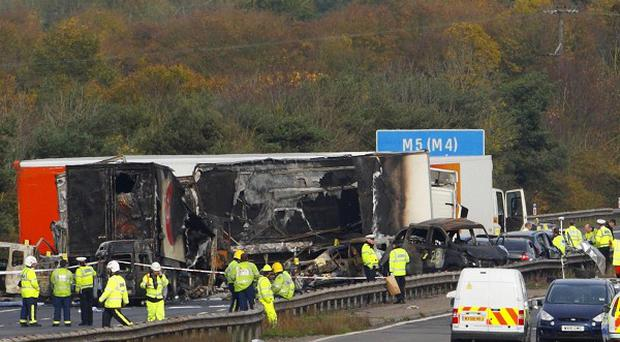 Emergency services working at the crash scene on the M5 motorway close to Taunton in Somerset