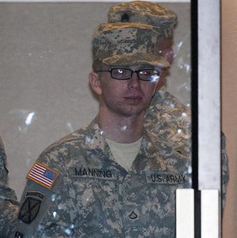 Pfc Bradley Manning is escorted out of a courthouse in handcuffs in Fort Meade (AP/Cliff Owen)