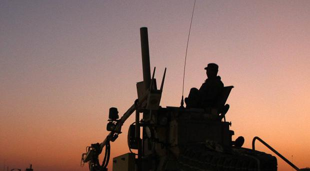 An armoured vehicle at Camp Adder during final preparations for the last American convoy to leave Iraq (AP/Maya Alleruzzo)
