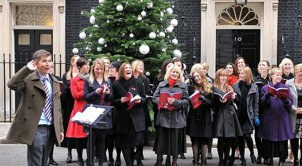 Gareth Malone conducts The Military Wives choir in Downing Street