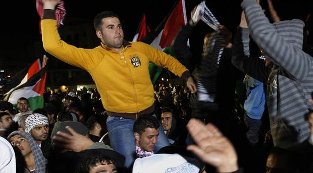 Released Palestinian prisoners and their relatives celebrate in the West Bank city of Ramallah (AP/Majdi Mohammed)