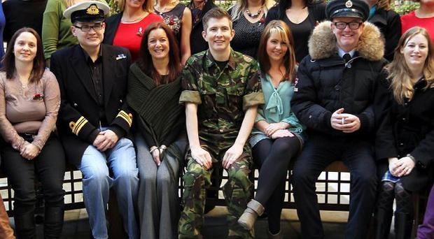 The Military Wives and Gareth Malone (centre) appear to have won the support of Simon Cowell