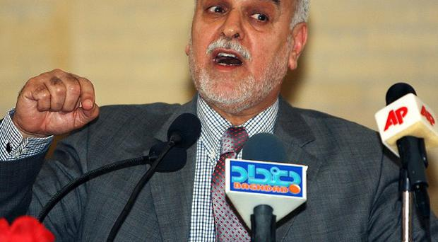 Iraq's vice president Tariq al-Hashemi denies running a hit squad that assassinated government and security officials (AP)