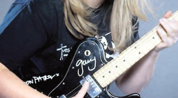 Orla Sheehan with the guitar