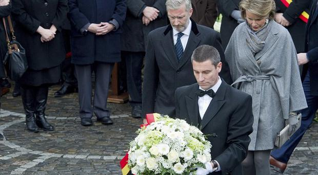 Belgium's Prince Philippe and Princess Mathilde prepare to lay a wreath during a memorial service in Liege (AP)