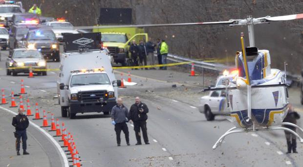 Traffic is stopped on a US highway where a plane crashed, killing five people (AP)