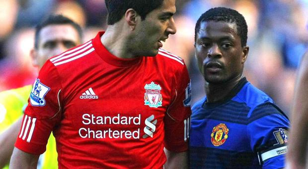 Suarez and Evra pictured during the October fixture