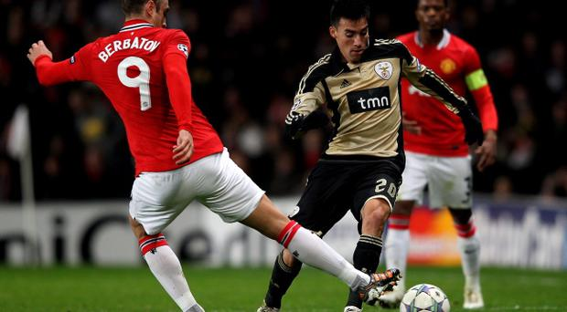 Nicolas Gaitan takes on Dimitar Berbatov as Benfica played Manchester United in the Champions League last month