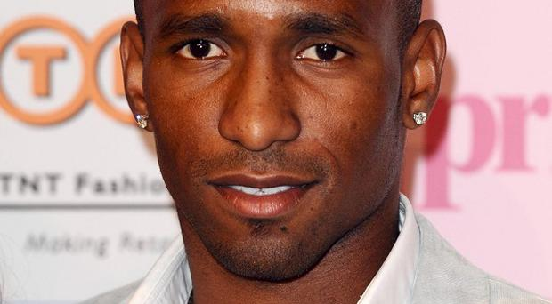 Jermain Defoe called for people across the world to tackle knife crime after the stabbing death of his cousin