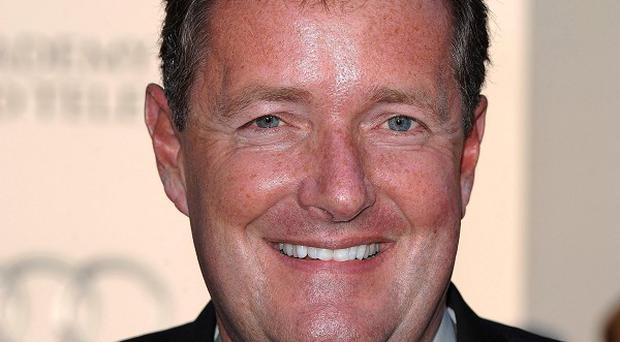 Piers Morgan has said he did not know about alleged phone hacking at the Daily Mirror