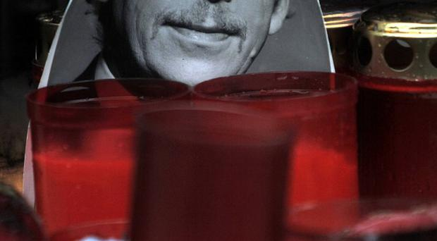 A portrait of Vaclav Havel stands next to candles at Wenceslas square in Prague (AP)