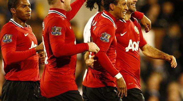 Manchester United's Ryan Giggs (right) celebrates scoring his side's third goal of the game with teammates during the Barclays Premier League match at Craven Cottage, London.