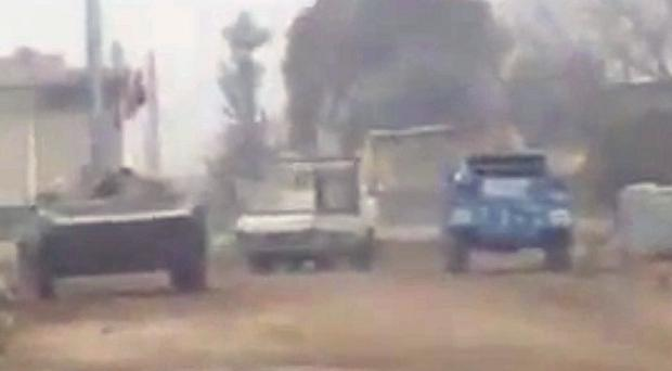 A shot taken from an amateur video shows Syrian military vehicles in Homs (AP)