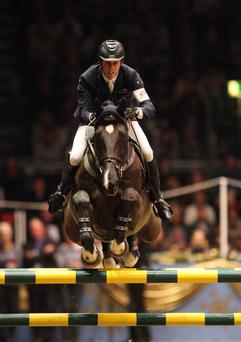 Ben Maher guides Tripple X to victory including clearing the very tricky Norwich City chopstick fence