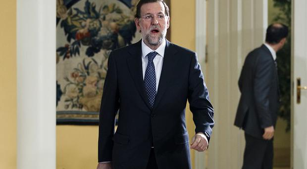Mariano Rajoy arrives to announce the new ministers of his cabinet after sworn in before King Juan Carlos to become Spain's new prime minister (AP photo)