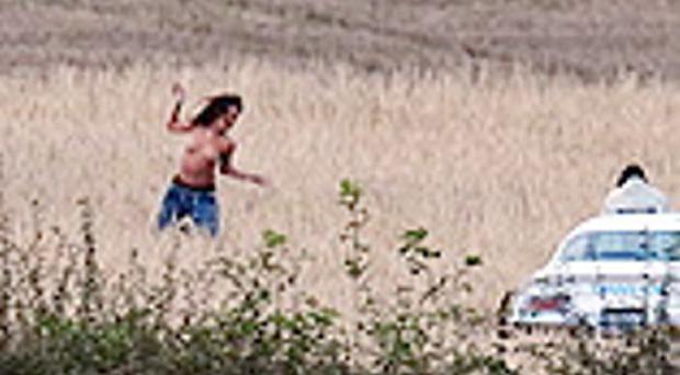 September 2011: A topless Rihanna romps through a field of wheat in Northern Ireland