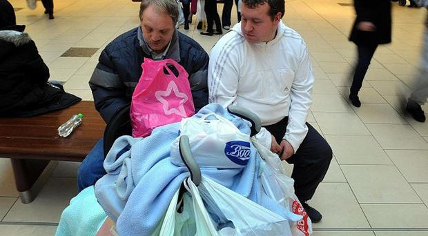 Panic-stricken shopping trips by men are likely to account for well over half of sales for retailers before Sunday