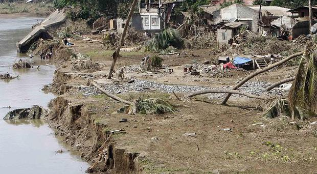 A UN official said parts of the Philippines that suffered flash flooding looked like they had been hit by a tsunami (AP)