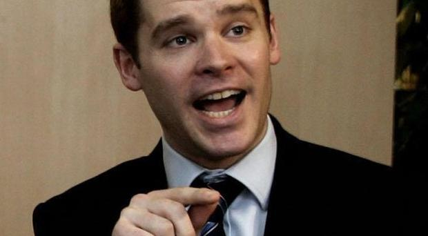 Conservative MP Aidan Burley has distanced himself from claims about a Nazi-themed stag party