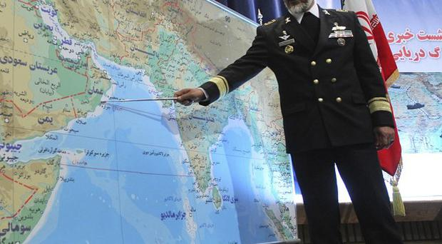 Iran's navy chief Admiral Habibollah Sayyari briefs the media on the Iranian navy's 10-day drill in international waters (AP)